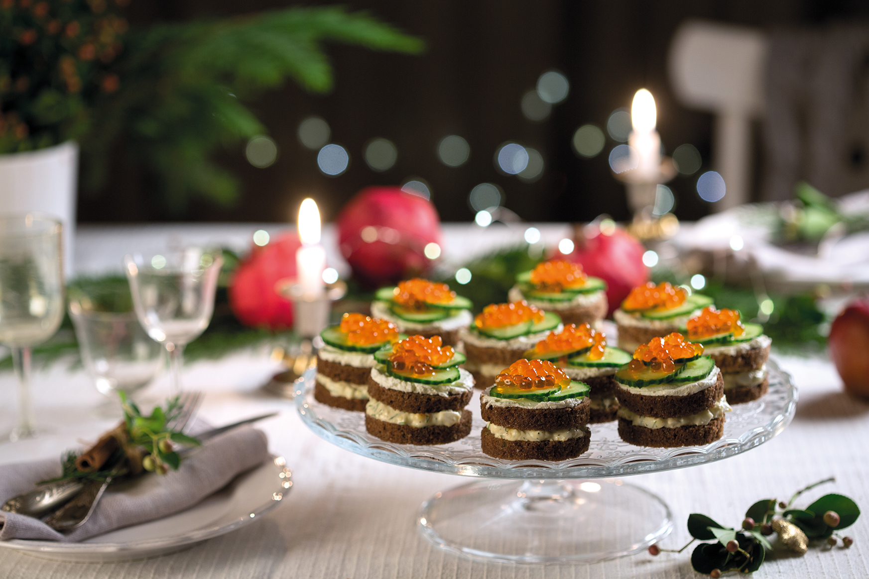 Festive rye bread canapés with egg salad and red caviare