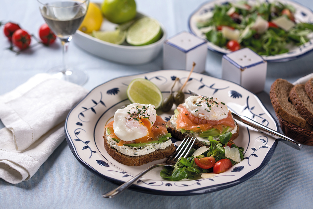Whole-grain protein toast sandwich with pouched eggs, salmon, cream cheese and avocado