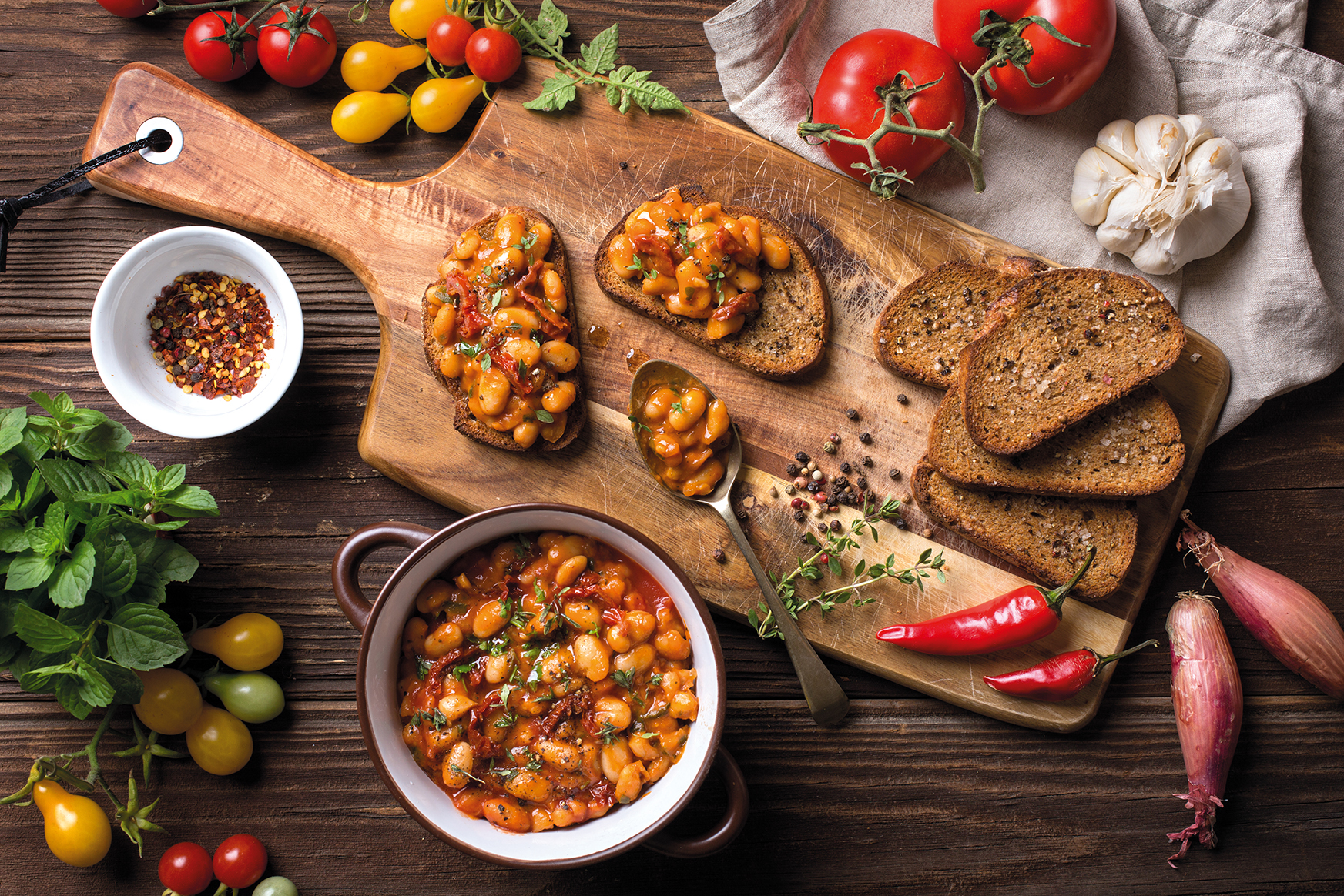 Whole-grain crostini with beans and dried tomatoes